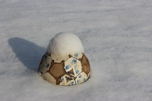 soccer ball in snow - (is soccer a winter or fall sport?)
