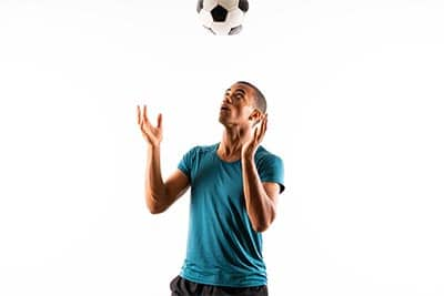 Soccer player juggling with head