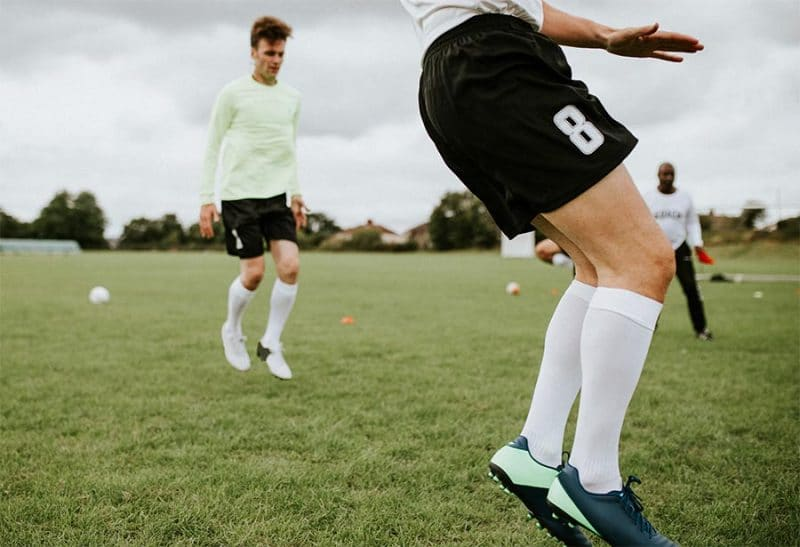 Players training in soccer compression socks