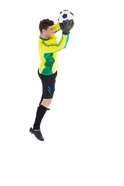 goalkeeper in a jump with the ball in hands (playing soccer FAQ)