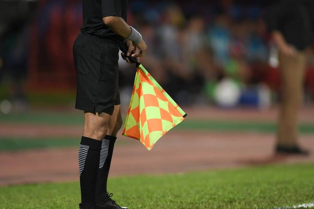 VAR decision and the assistant referee with the flag down.  (Is VAR good for soccer?)