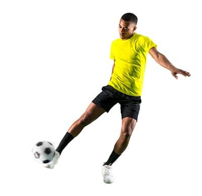 soccer player stretching to strike the ball (playing soccer FAQ)