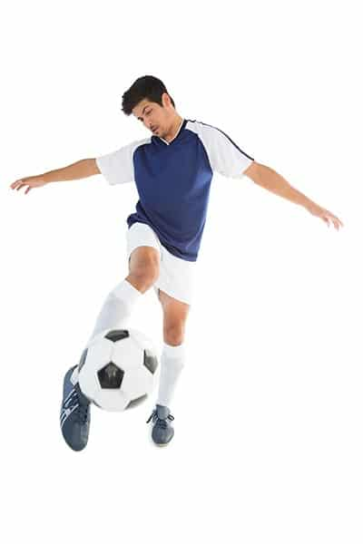 soccer player volleying with laces