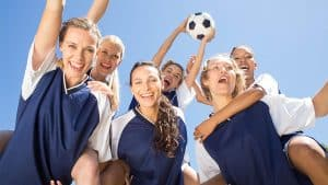 soccer players celebrating with a ball e1577269997680