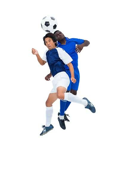 two soccer player jumping for a header (playing soccer FAQ)