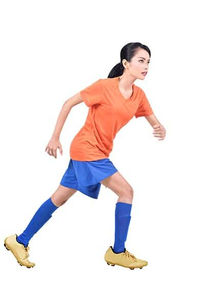 woman soccer player running (playing soccer FAQ)