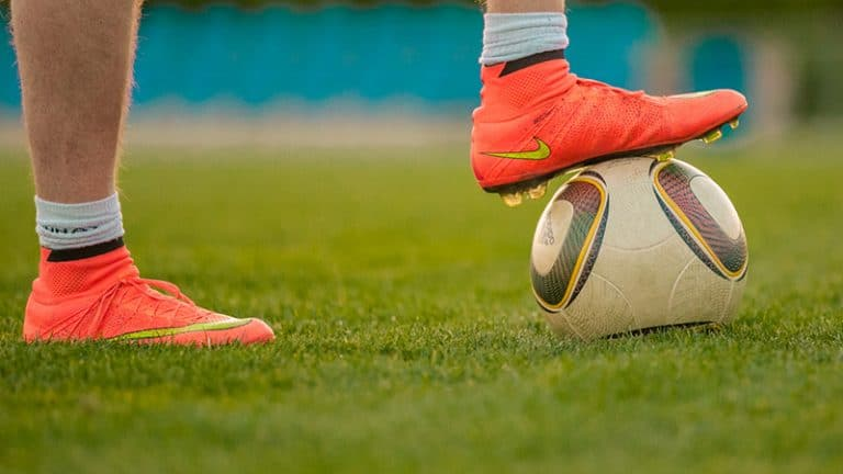 Soccer cleats foot on ball