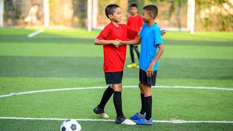shaking hands with another soccer player youth