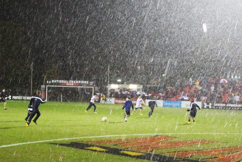 soccer game with heavy rain