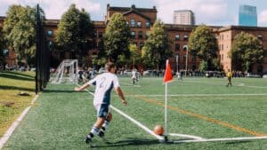 ○ How did Soccer Spread Globally? Popular History (Amazing Changes) ○ Soccer PLayer taking a corner kick e1605194595920