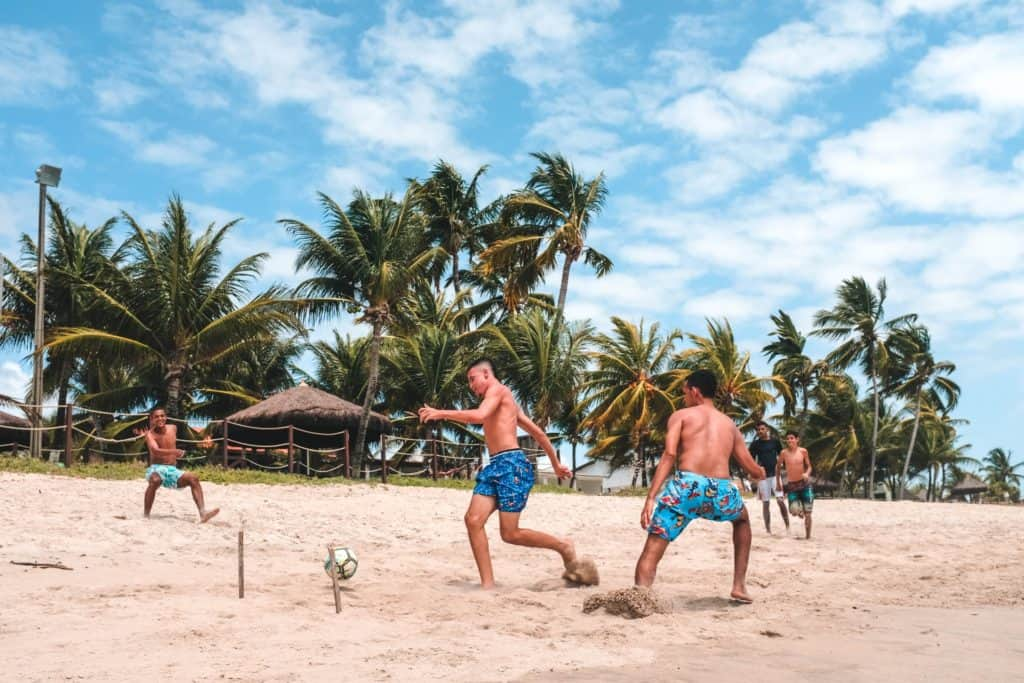 Playing soccer on the beach