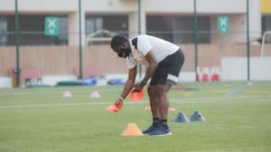 Soccer coach preparing training practice