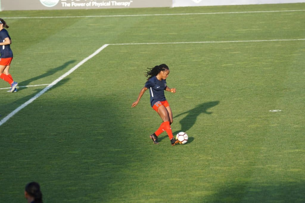 Youth female soccer player on the ball