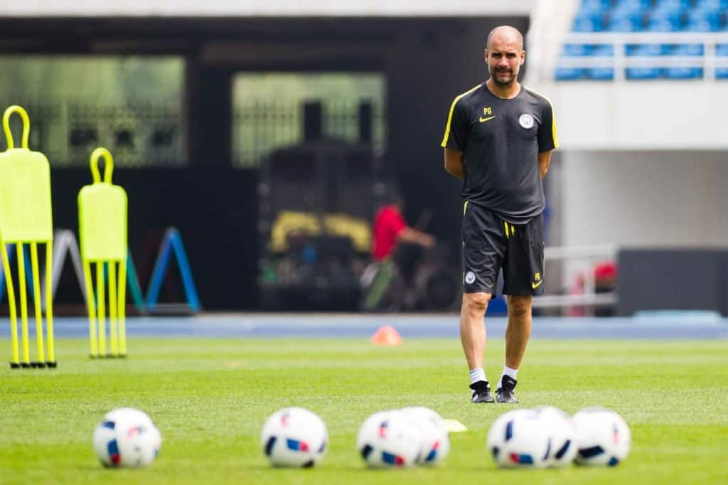 Head coach Pep Guardiola of Manchester City watches his players during a training session for the Beijing match of the 2016 International Champions Cup China in Beijing, China, 24 July 2016