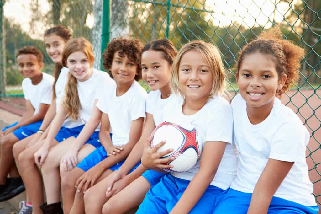 Youth Soccer Players Sitting on a Bench