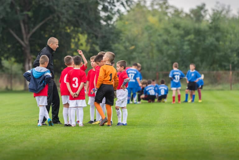 Youth Soccer Teams Half Time Talk With Their Coach