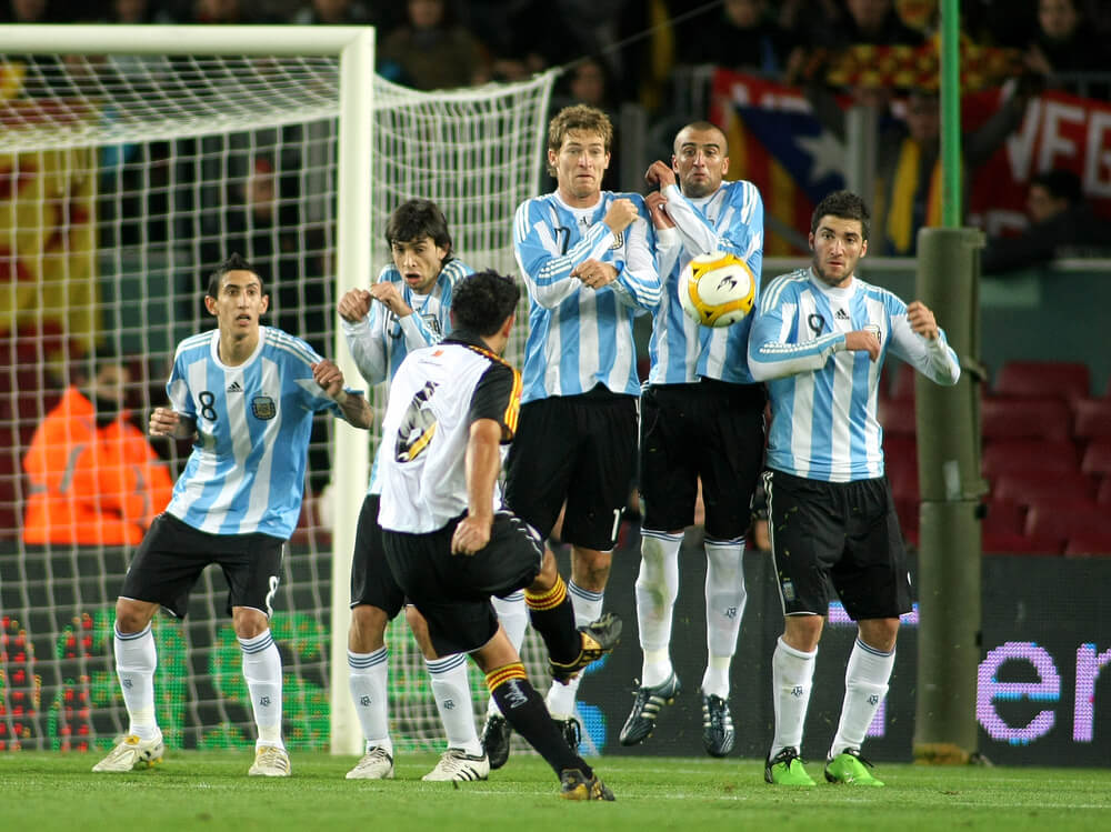 Argentinian Players In A Wall Of The Free Kick - Taken by Xavi Hernandez