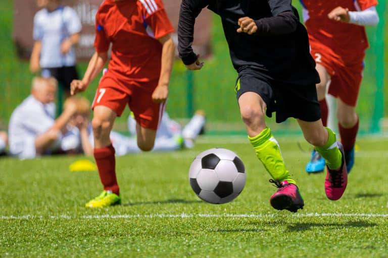 Kids Playing Youth Soccer - Turf Level