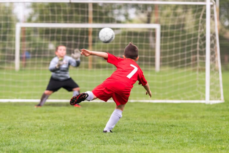 Youth Soccer Player Heading a Shot at Goal