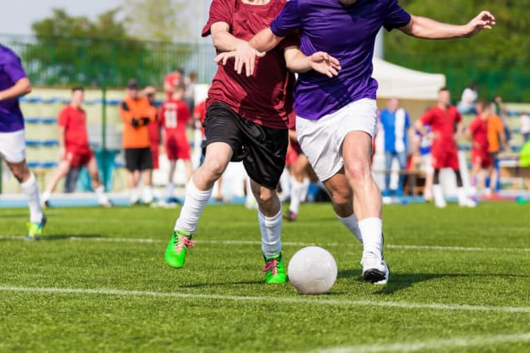 Youth Soccer Players - Two players battling for the ball