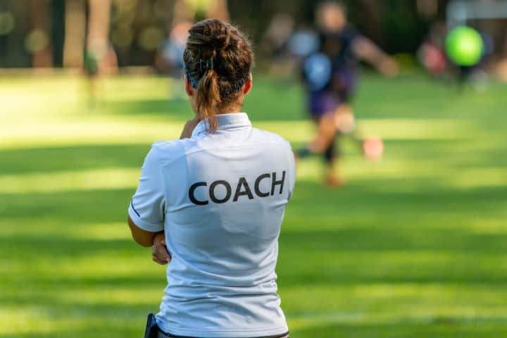 A Female Soccer Coach - Watching a Training Session