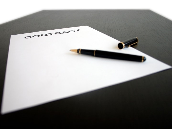 ○ Release Clauses in Soccer: What Really Happens ○ Contract on a desk