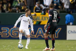CARSON, CA. - MAY 7: Los Angeles Galaxy M David Beckham #23 keeps the ball away from New York Red Bulls F Thierry Henry #14 during the MLS game on May 7 2011 at the Home Depot Center.