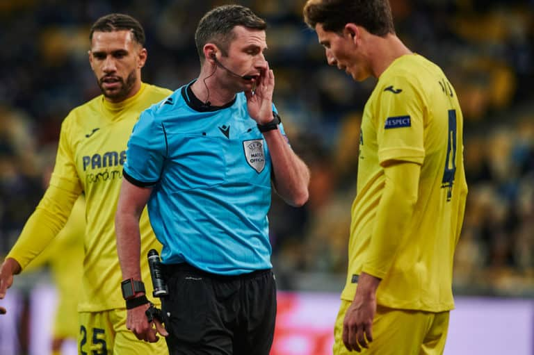 KYIV, UKRAINE - MARCH 11, 20214 defender Pau Torres talking with referee during the match of UEFA Europa League Dynamo Kyiv vs Villarreal at NSC Olympic in Kyiv