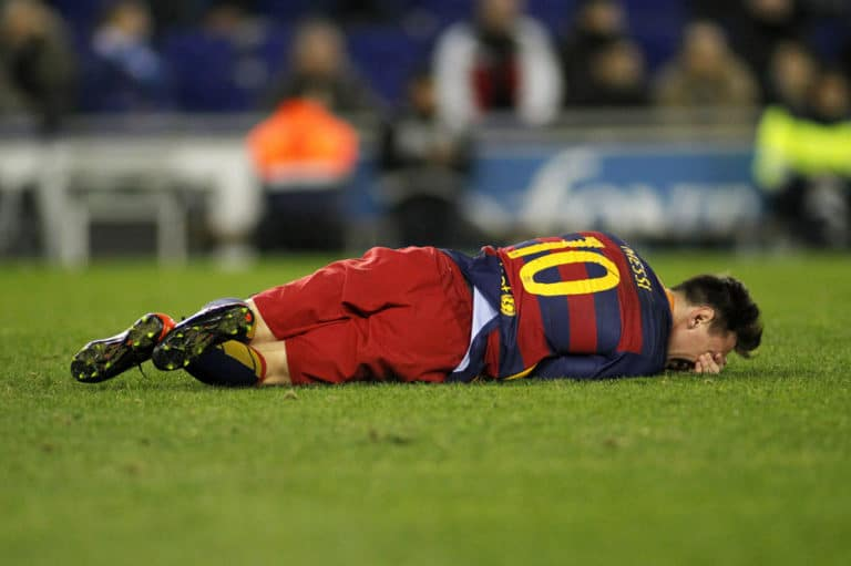 Leo Messi of FC Barcelona - Injured on the turf