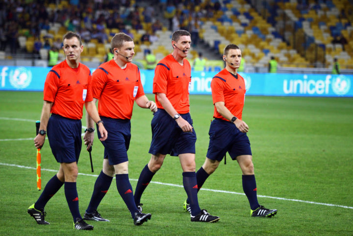 ○ Can A Soccer Referee Change A Decision? ○ Soccer Referee and Assistants on The Field e1630091228140