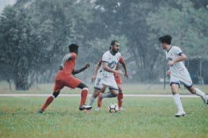 Soccer game in the rain