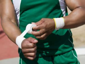 Soccer player taping wrists