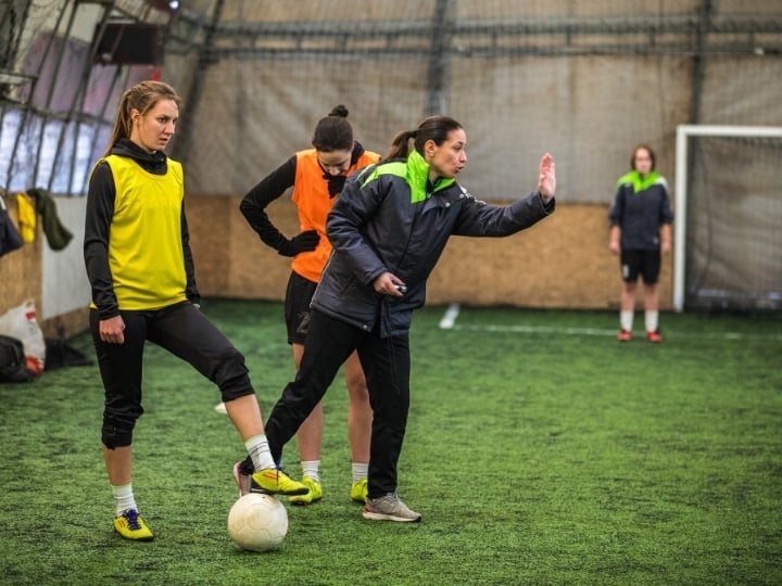 Womens indoor soccer game players and referee