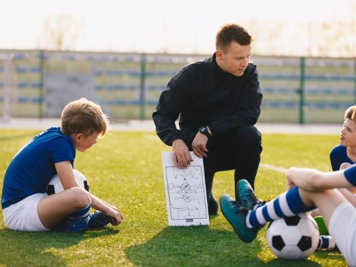 Youth soccer coach and players