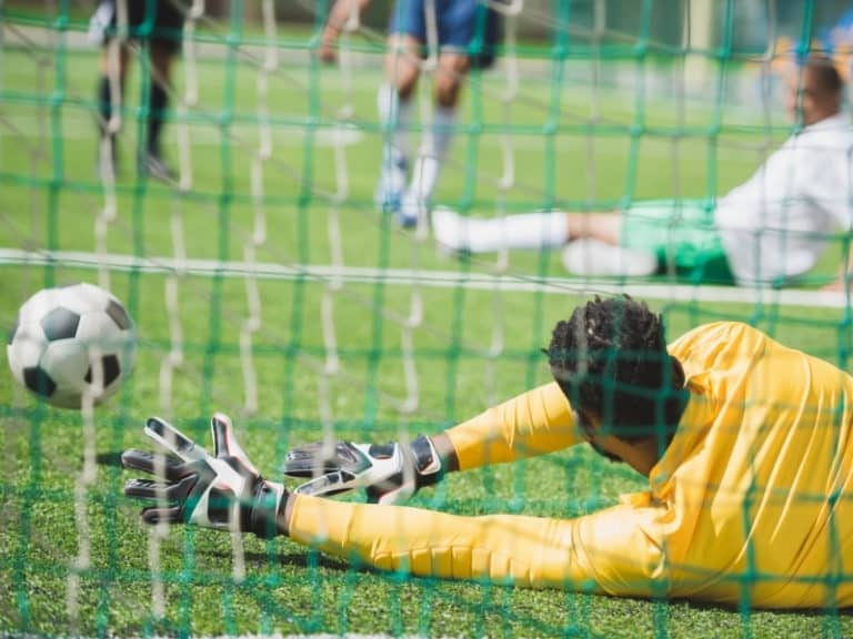 A Goalkeeper Making a Save With His Hands