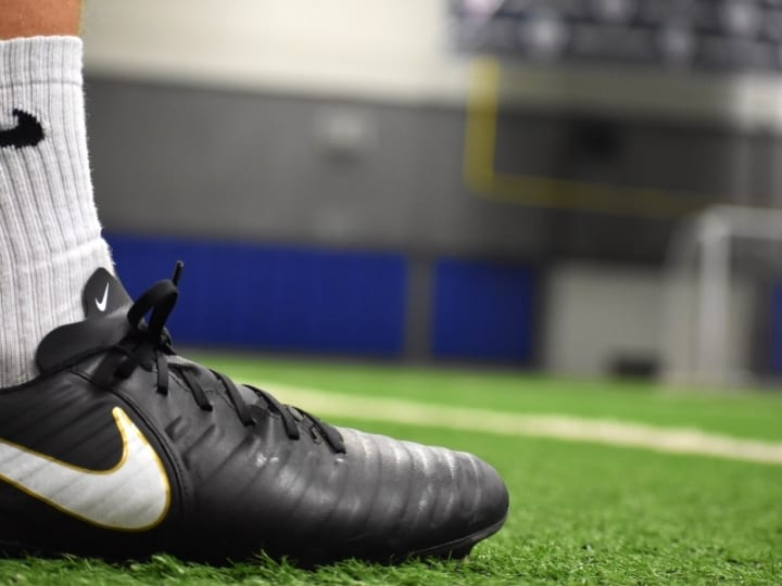Nike Soccer Cleats A Players Foot on The Field