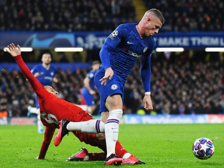 LONDON, ENGLAND FEBRUARY 26, 2020 Thiago Alcantara of Bayern and Ross Barkley of Chelsea pictured during the 2019.20 UEFA Champions League Round of 16 game Chelsea FC vs. Bayern Munich at Stamford Bridge