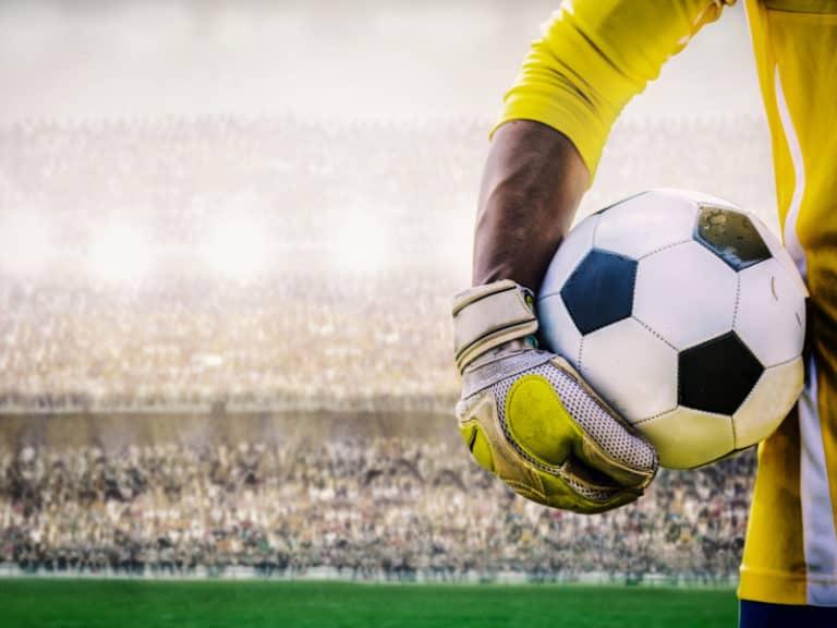 Goalkeeper holding a soccer ball